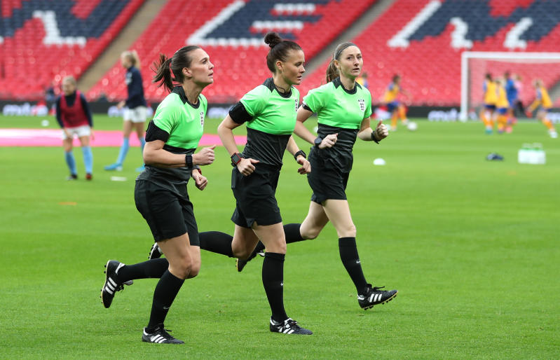Referee Rebecca Welch (centre), Sian Massey Ellis (right) and Natalie Walker